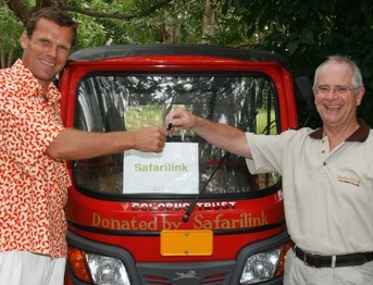 Safarilink's Managing Director&sbquo John Buckley&sbquo hands over the keys to the tuk-tuk donated by SafariLink to Eirik Jarl Trondsen&sbquo Manager&sbquo Colobus Trust.