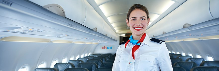 Chair Airlines Flight Attendant standing in aisle of A319 aircraft